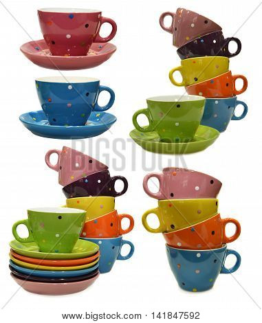 Design set with colorful tea cups and saucers, kitchen objects isolated on white