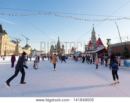 Moscow - November 29 2015: Beautiful Christmas ice rink on Red Square and a lot of people are skating during the Christmas holidays and unusual St. Basil November 29 2016 Moscow Russia
