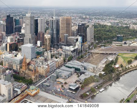 Melbourne - February 23 2016: View from the top of the city and see the skyscrapers Federation Square the Yarra River and the train station Flinders Street Station February 23 2016 Melbourne Australia