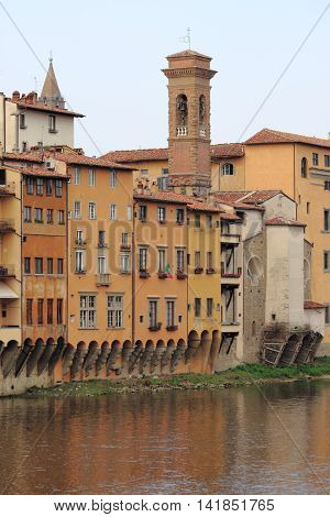 Medieval buildings along the banks of the Arno River in Florence Italy