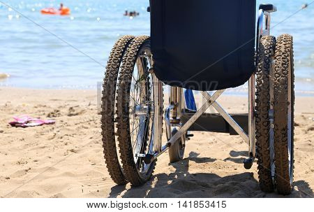 Wheelchair On The Beach By The Sea