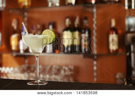 Cocktail in glass on bar counter