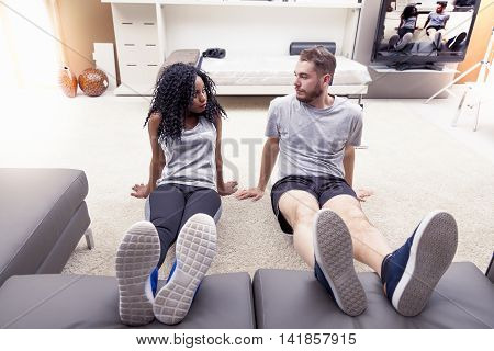 Young Couple Are Training Doing Gymnastics At Home