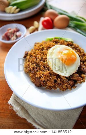 Indonesia Nasi Goreng fried rice with egg on white plate