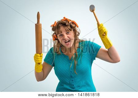 Crazy Housewife With Kitchen Roller And Meat Hammer