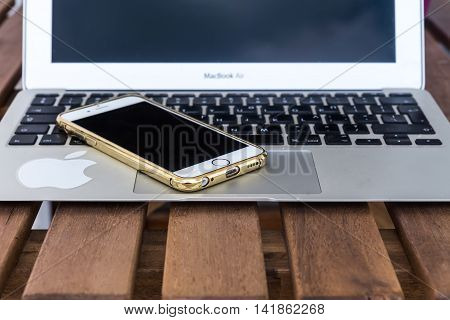 Laptop And Phone Apple On A Wooden Table