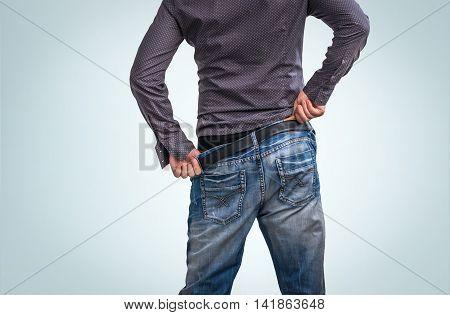 Man Adjusts After Peeing
