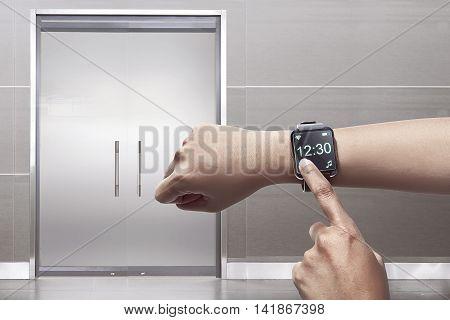 Arm with modern smartwatch display menu. Touchscreen