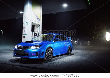 Moscow, Russia - June 18, 2016: Blue car Subaru Impreza WRX STI stay on fuel station in city Moscow at night