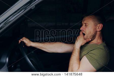 Man falling asleep in car