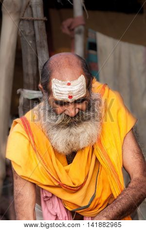 ALLAHABAD, INDIA â?? FEB 14th - A brahmin priest sporting white horizontal lines on his forehead denoting him as a follower of the Hindu god Shiva at  the Kumbha Mela on February 14th 2013