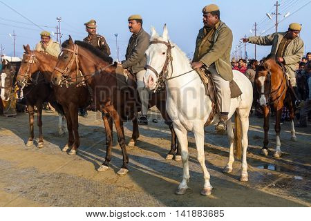ALLAHABAD INDIA - FEB 10 - Mounted policemen on watch during the festival of Kumbha Mela on February 10th 2013 at Allahabad India.