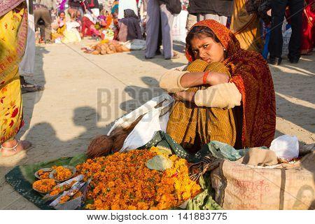 Indian Girl Selling Flowers At The Kumbha Mela, India.