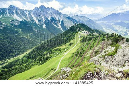 Mountain Landscape With Trail, Green Meadow And Forest