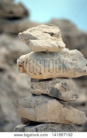 Pyramid of stones on the mountainside Stability and Equilibrium