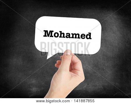 Mohamed written in a speechbubble