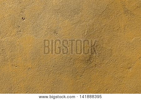 Plaster, plaster texture, plaster background. Old brick wall with plaster, photo texture, seamless background, yellow background