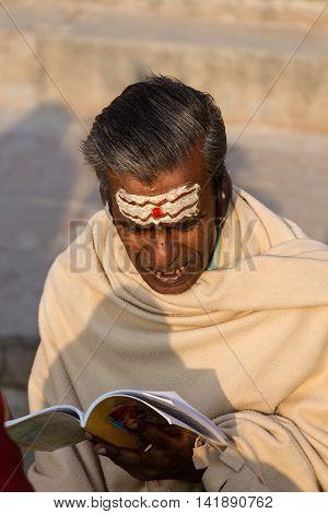 VARANASI, INDIA - FEB 18 - A brahmin recites Hindu Sanskrit texts in Varanasi on February 18th 2013
