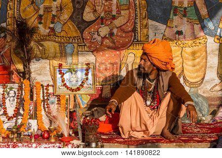 VARANASI, INDIA - FEB 18 - A sadhu in Varanasi sitting in his makeshift shrine.