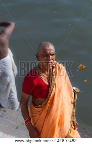 VARANASI, INDIA - FEB 18 - A cleanly shaved Hindu lady at the ghats of Varanasi on February 18th 2013