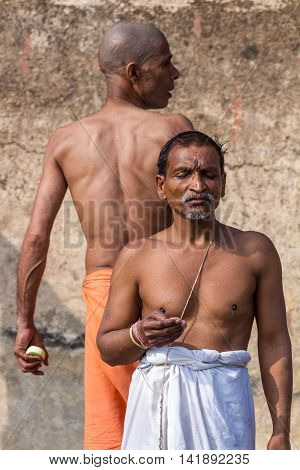 VARANASI, INDIA - FEB 18 - Hindu man offers prayers to the sacred river Ganges.