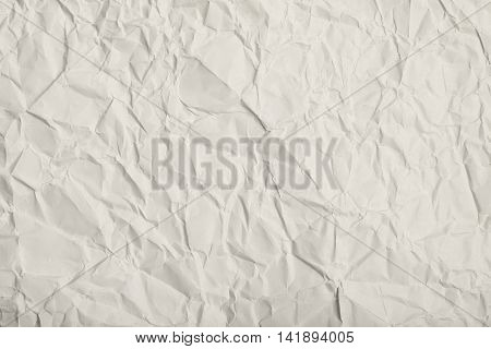 Close-up fragment of a gray crumpled paper texture as a backdrop composition
