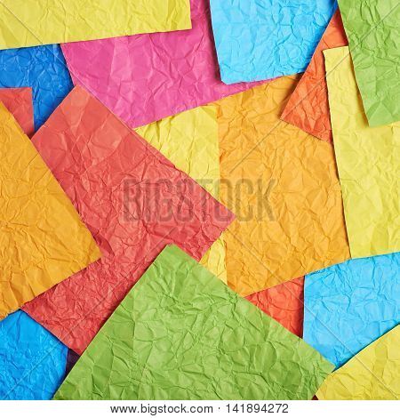 Surface coated with the multiple colorful crumpled origami paper sheets as an abstract background composition