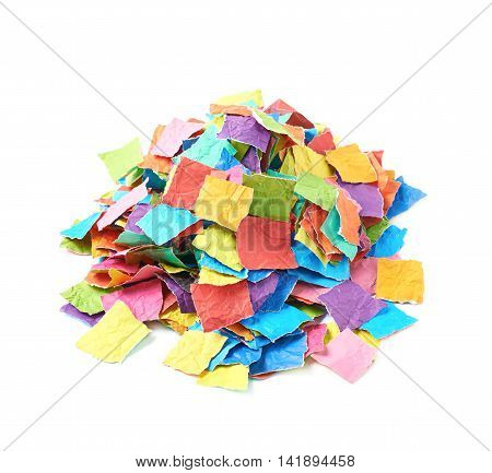 Pile of multiple colorful torn paper pieces isolated over the white background