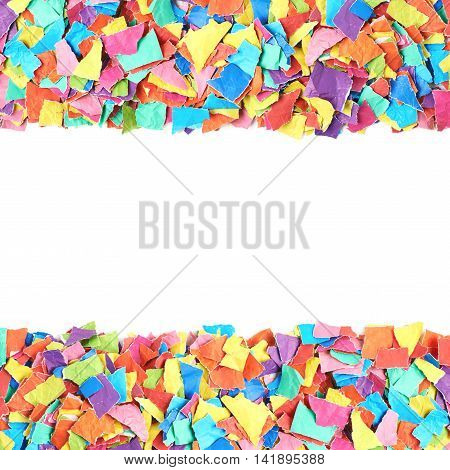 Abstract copyspace backdrop composition with the borders made of colorful torn pieces of paper isolated over the white background