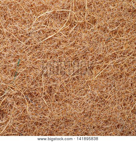 Close-up texture fragment of an artificial kitchen sponge