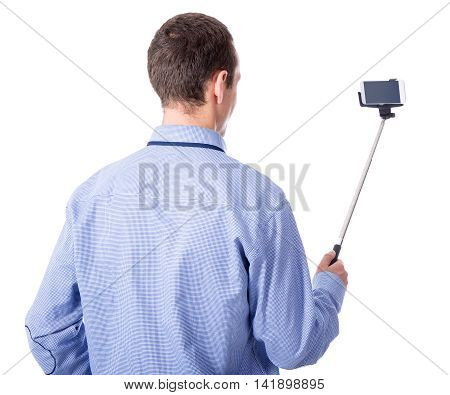 Young Business Man Taking Selfie Photo With Smart Phone On Selfie Stick Isolated On White