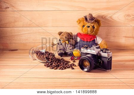 Old Vintage Camera And Teddy Bear On Wooden Background.
