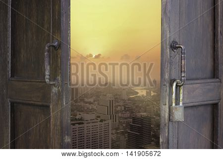 abstract old window open to city view of bangkok and river and sunset - can use to display or montage on products