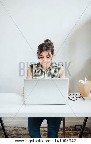 Busy woman designer having lunch in office