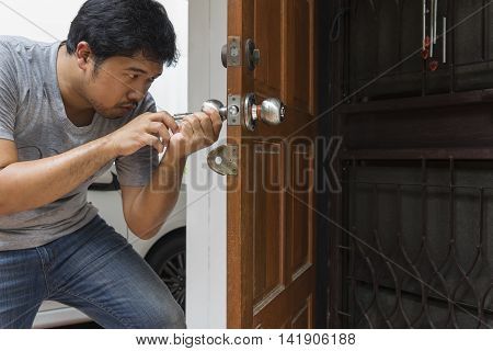 locksmith open the wood door by key maker tools at home - can use to display or montage on product