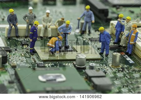 engineers are fixing chip-set on green mainboard - can use to display or montage on products