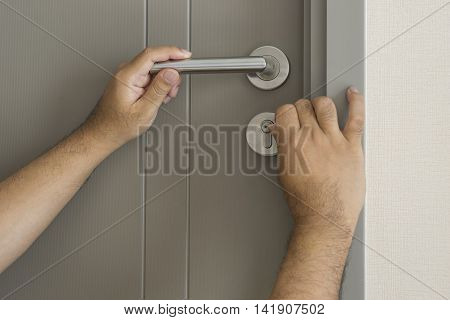 locksmith try to open the door by technique with screwdriver - can use to display or montage on product