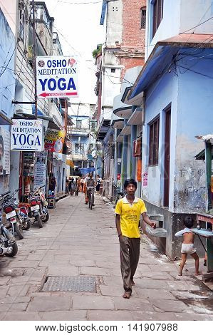 Varanasi, India - Jule 30, 2011: uknown passerby near the Osho yoga center