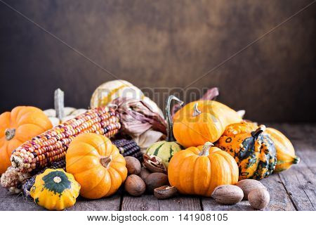 Variety of colorful decorative pumpkins on a woodentable