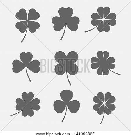 Vector set icons of three and four leaf clover. Irish symbol of luck and St Patrick's Day. Dark silhouettes of clover leaves in a flat style.