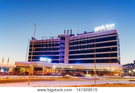 "NIZHNY TAGIL RUSSIA - FEBRUARY 13 2016: The hotel ""Park inn"" with evening lights at sunset in winter"