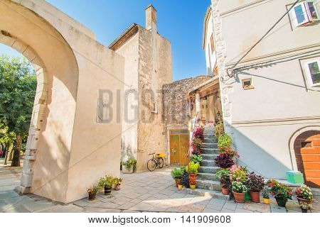 Street and old houses in Old Town of Cres, Croatia, Mediterranean ambient