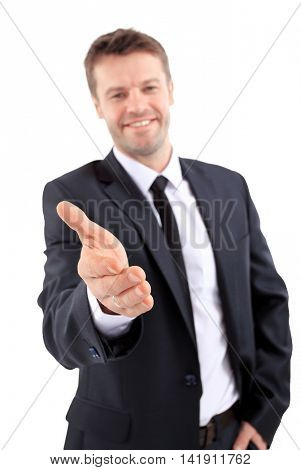 Portrait of a successful business man giving a hand on a white b
