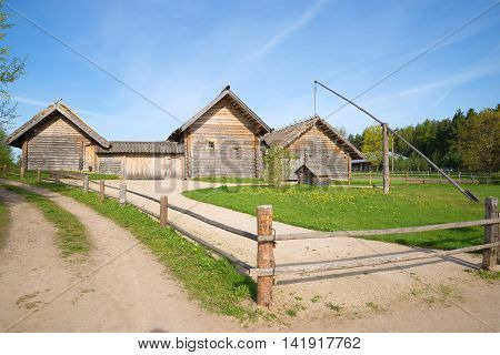 PSKOV REGION, RUSSIA - MAY 08, 2016: Reconstruction of a prosperous peasant farmsteads of the eighteenth century. The village Bugrovo, Pushkinskie Gory, Russia. Historical landmark