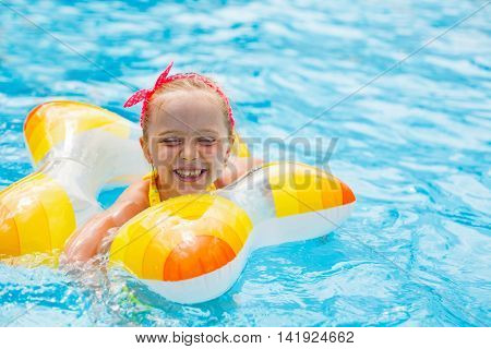 Pretty Little Girl Learning To Swim In The Pool With A Lifeline