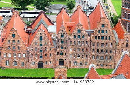 Salzspeicher (salt storehouses) of Lubeck at night, Germany. Historic brick buildings on the Upper Trave River.  Lubeck, Germany