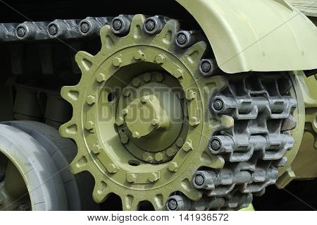 A close-up of tank caterpillar tread with wheels