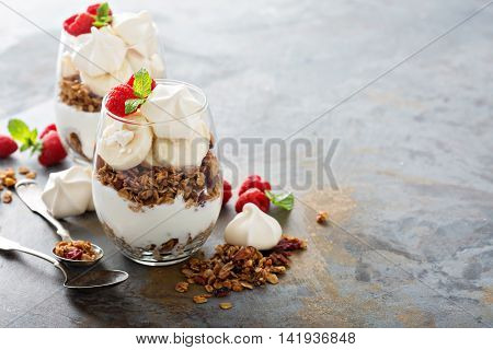 Banana and granola breakfast parfait with meringue