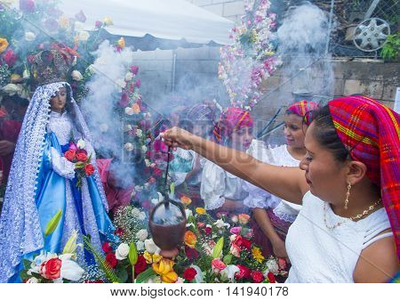 PANCHIMALCO EL SALVADOR - MAY 08 : Salvadorian women participate in the procession of the Flower & Palm Festival in Panchimalco El Salvador on May 08 2016