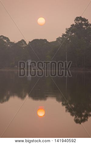 Sunrise over lake at Angkor Thom in Siem Reap Cambodia. Angkor Thom is a popular tourist attraction